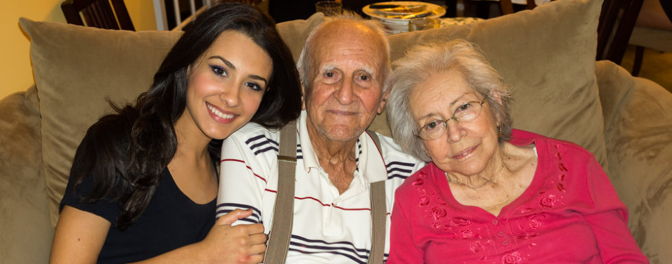 Grandparents with granddaughter in a home setting